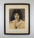 Image of Untitled [woman with dark hair and oval necklace]
